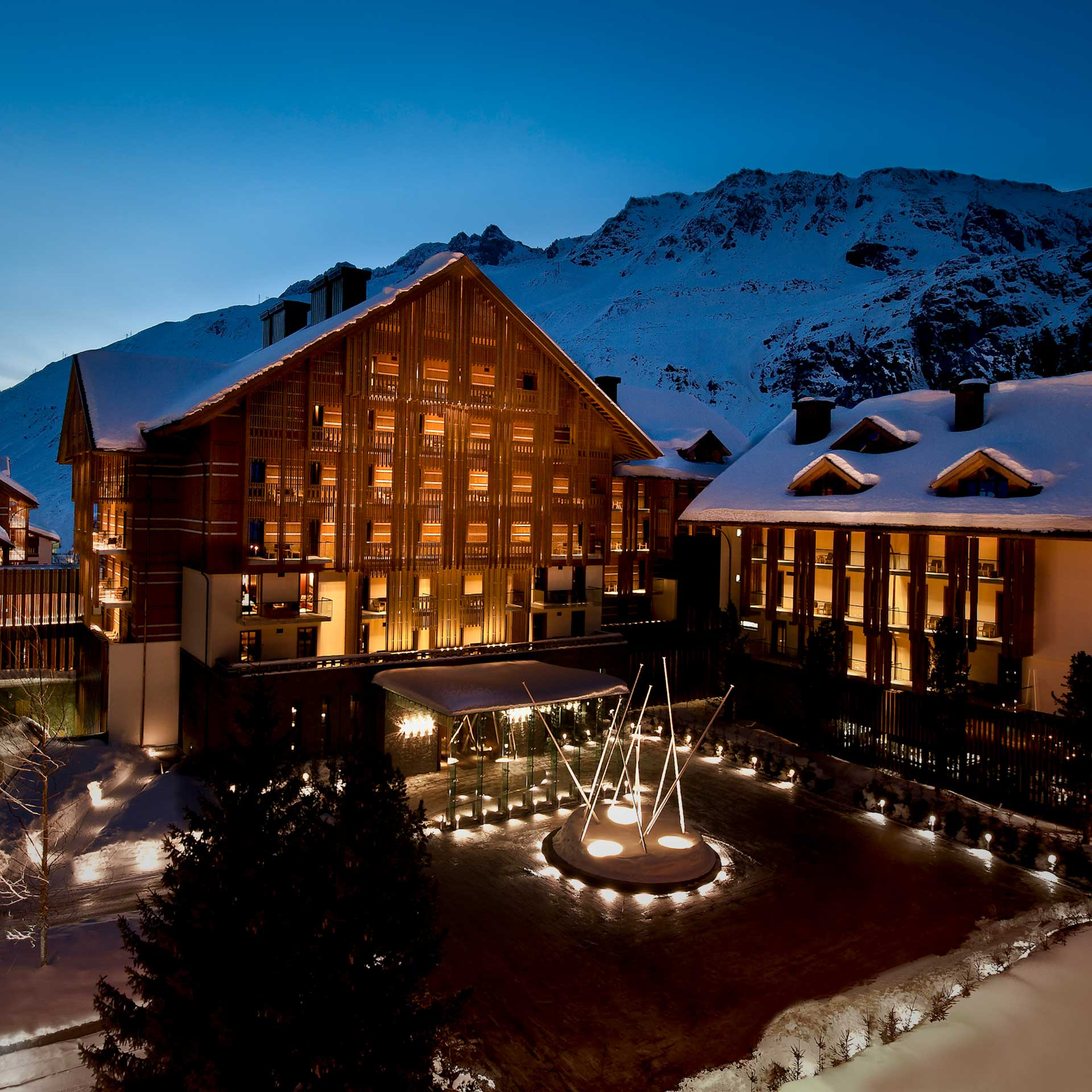 Aerial view of the Chedi Andermatt at night | Luxury hotel marketing | General Hotel Management