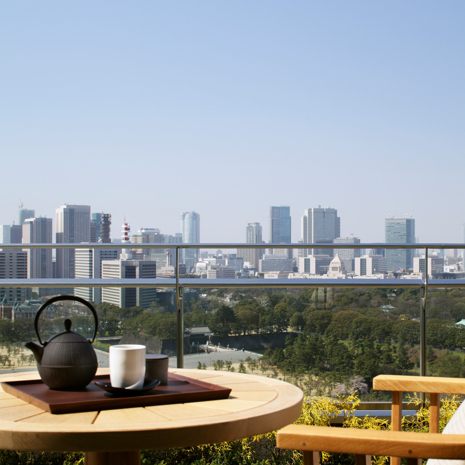 View from the balcony of a guestroom, with Japanese tea service | International Marketing | Palace Hotel Tokyo