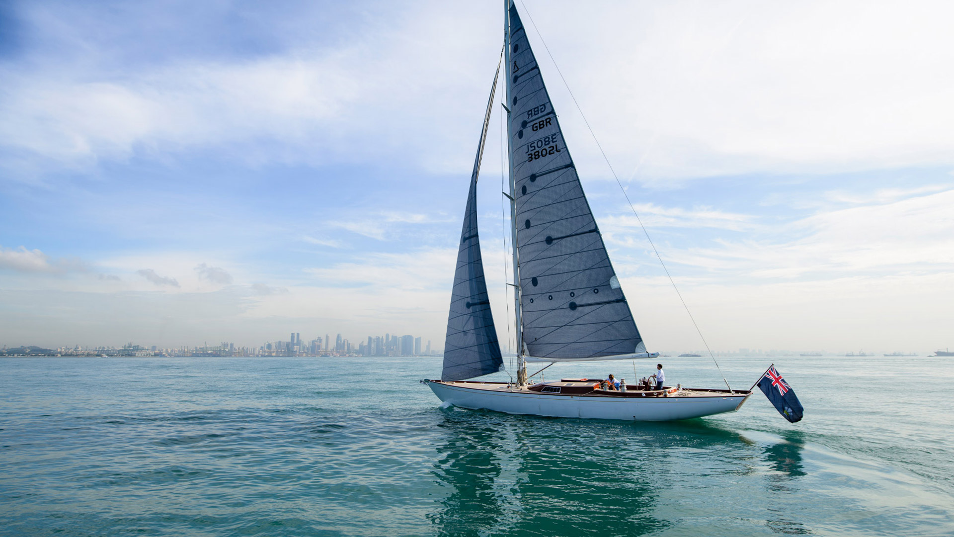 View of a luxury yacht sailing of the coast of Singapore | Luxury yacht marketing | Spirit Yachts