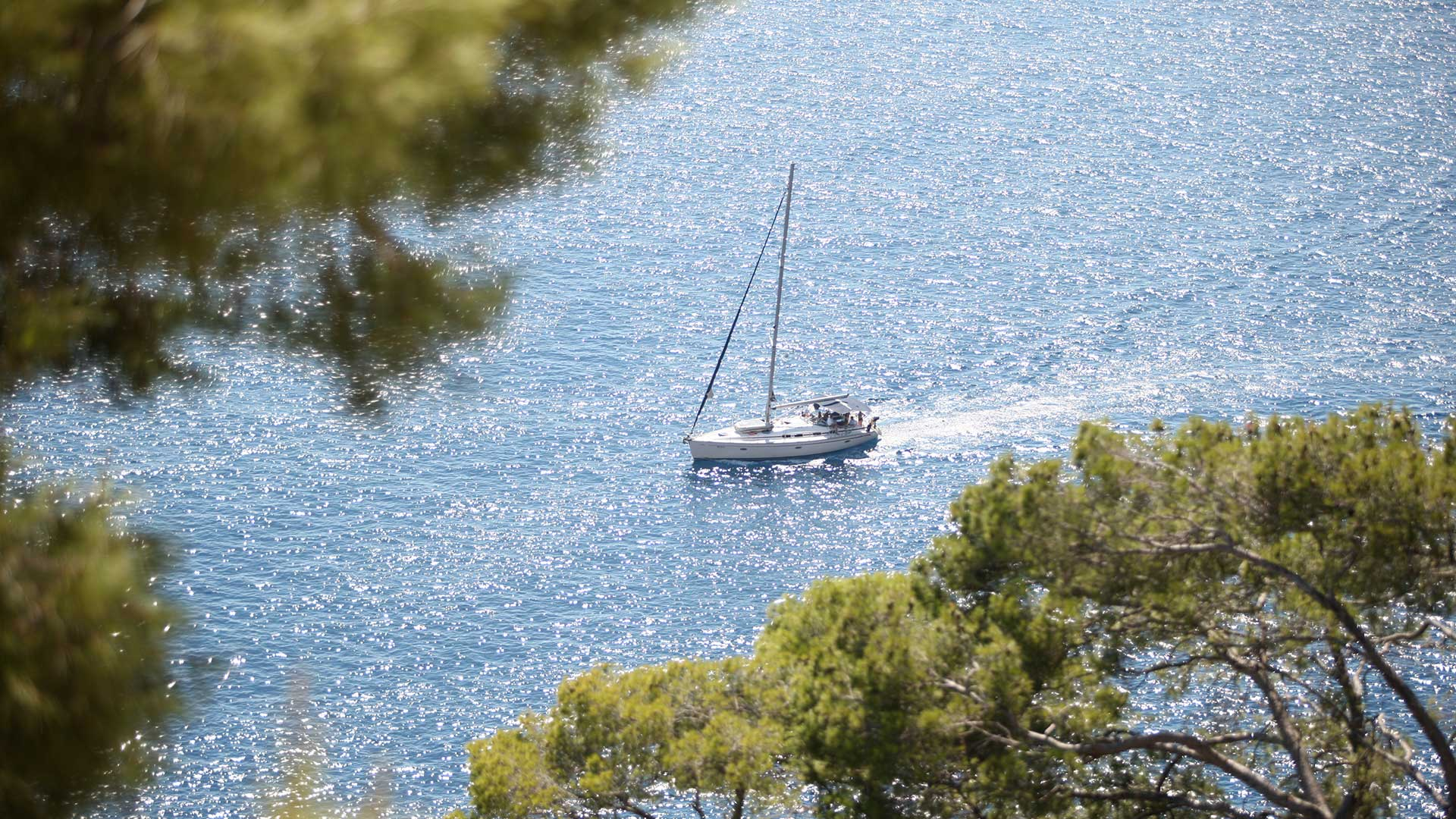 Aerial photograph of a yacht sailing around Hvar island | Luxury Resort marketing | St Juraj