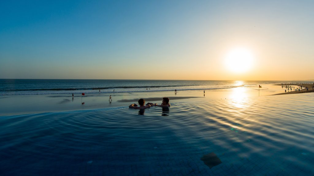 View of the infinity pool at sunset at The Legian Bali | Luxury hotel marketing | Legian Hotel Management