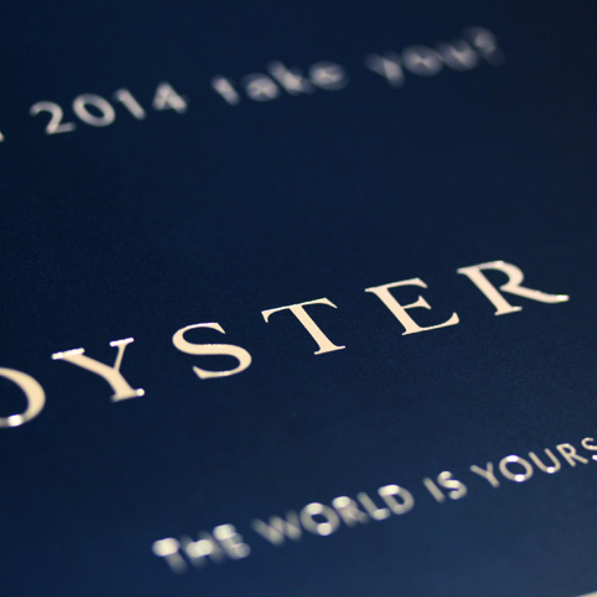 Close-up of silver foil logo and tagline | Luxury yacht marketing | Oyster Yachts