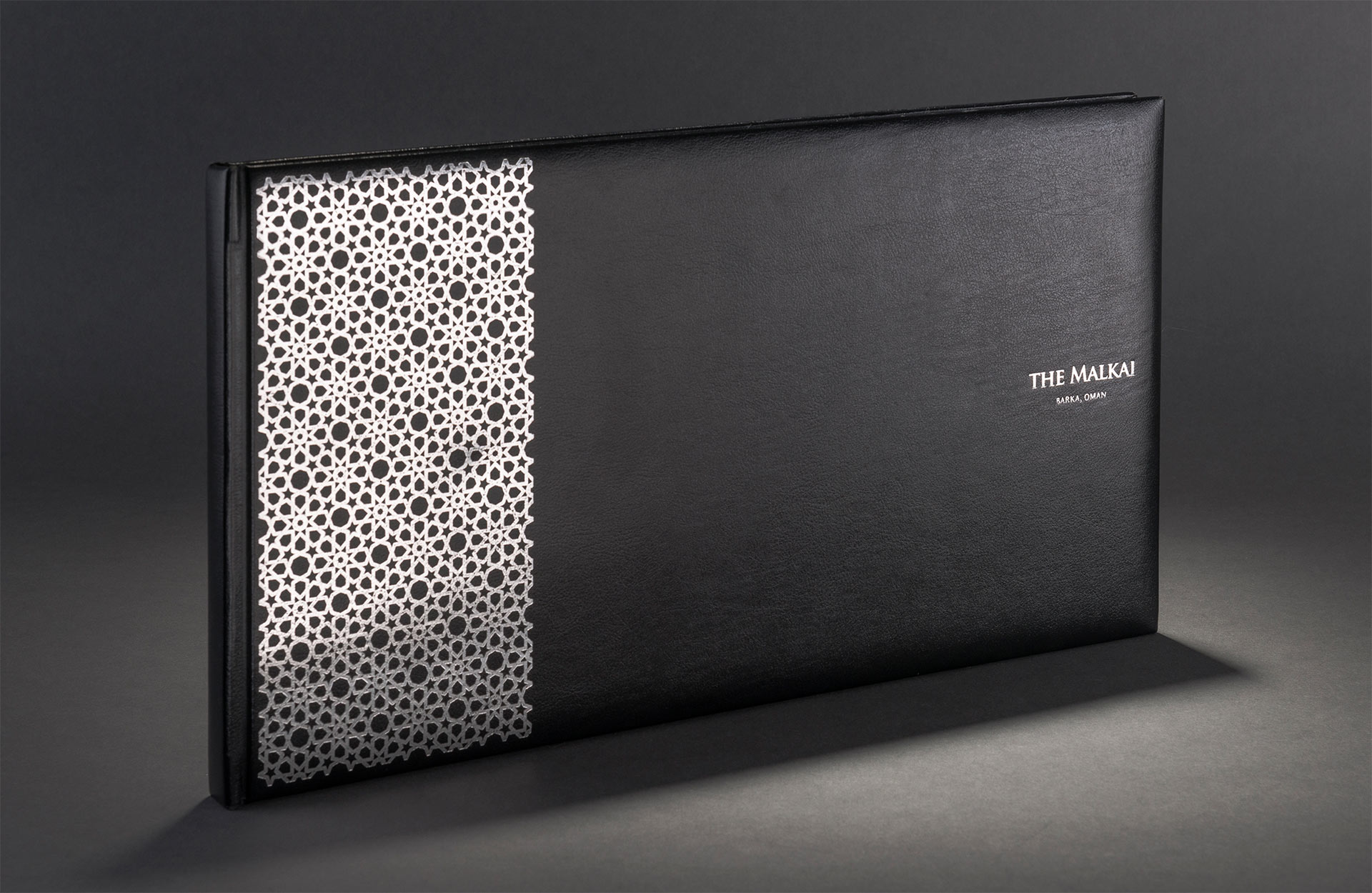 Brochure cover with silver foil detail | Luxury resort marketing | The Malkai