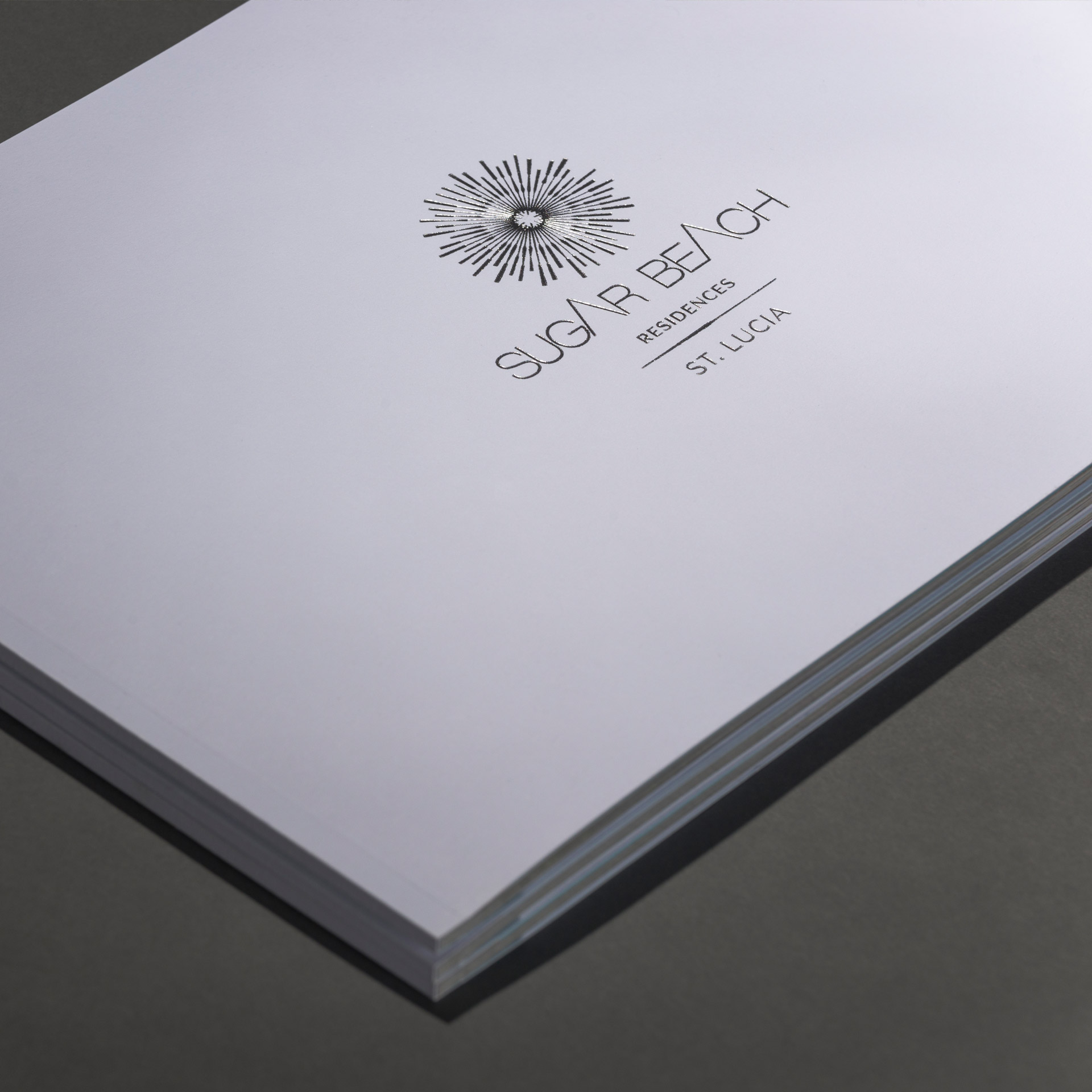 Brochure cover with silver foil detail | Luxury real estate marketing | Viceroy Sugar Beach