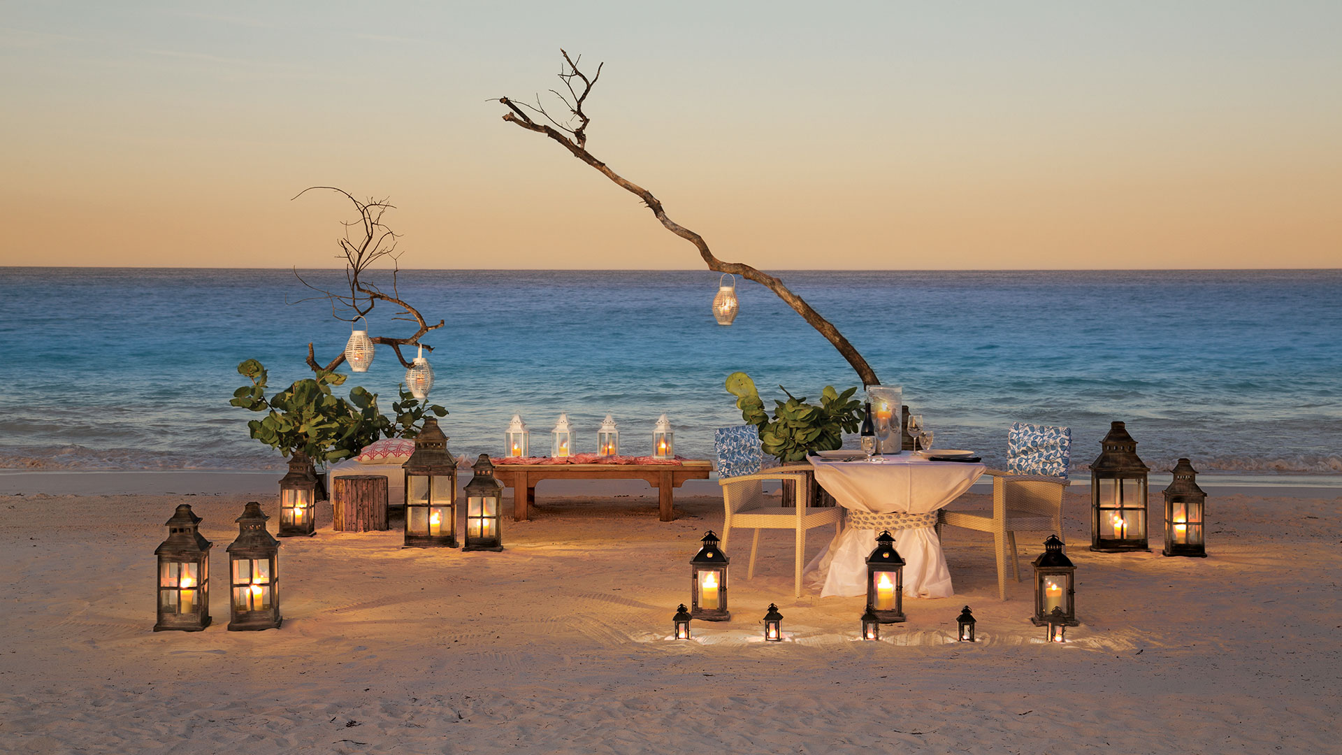 Private dining on Pink Sands beach | Luxury real estate marketing | Pink Sands